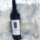 A bottle of 2015 Hightower Cabernet Sauvignon perched in a snowbank during Snowmageddon 2019.