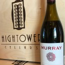 A bottle of 2016 Murray Syrah, Hightower Cellars logo boxes in the background.